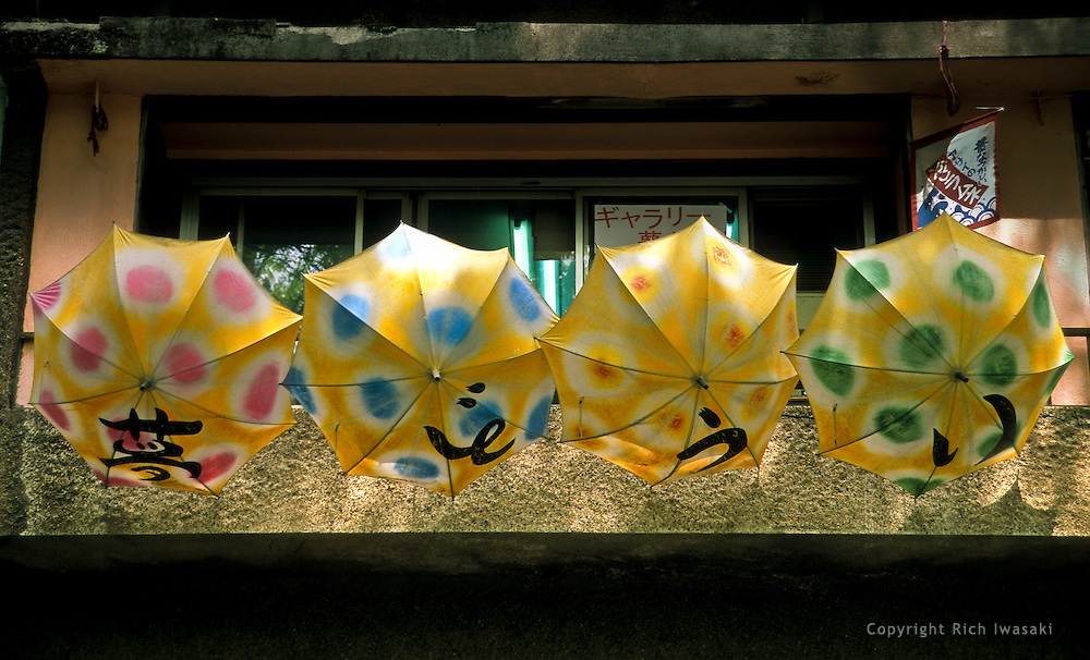 Umbrellas hang from the terrace of an art gallery on Omotesando-dori (street) in the Harajuku district of Tokyo, Japan