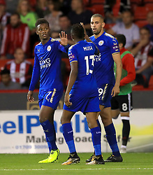 Leicester City's Demarai Gray celebrates scoring his side's first goal of the game with team mate Leicester City's Ahmed Musa during the Carabao Cup, Second Round match at Bramall Lane, Sheffield.