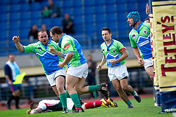 Tit Hocevar of Slovenia celebrate scoring after a try at rugby match between National team of Slovenia (green) and Bulgaria (white) at EUROPEAN NATIONS CUP 2012-2014 of C group 2nd division, on April 12, 2014, at ZAK Stadium, Ljubljana, Slovenia. (Photo by Matic Klansek Velej / Sportida.com)