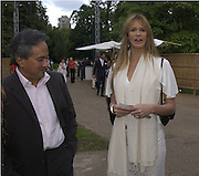 Anish Kapoor and Elle Macpherson. Serpentine Gallery Summer party in a glass and steel pavilion designed by Toyo Ito and Arup. . tuesday 9 July 2002. © Copyright Photograph by Dafydd Jones 66 Stockwell Park Rd. London SW9 0DA Tel 020 7733 0108 www.dafjones.com