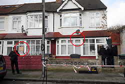 **EDITORS NOTE: Red circles indicate where gunshot hit the properties**<br /> © Licensed to London News Pictures. 04/04/2018. London, UK. A specialist police team search for a bullet at a properties hit by gunshot on Chalgrove Road in Tottenham, where 17 year old Tanesha Melbourne was shot dead. A recent spree of killings in the capital has taken the murder toll for the year so far to 48. Photo credit: Ben Cawthra/LNP