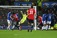 Anthony Martial of Manchester United (11) curls the ball into the top corner and scores his teams 1st goal. Premier league match, Everton v Manchester Utd at Goodison Park in Liverpool, Merseyside on New Years Day, Monday 1st January 2018.<br /> pic by Chris Stading, Andrew Orchard sports photography.