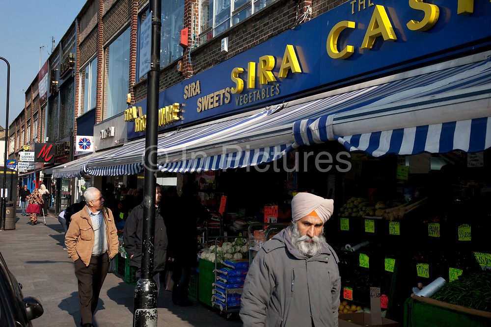 Sikh man passes the Sira cash and carry in Southall in West London, also known as 'Little India' by some, is an area almost completely populated by people from South Asia. Figures show that the area is approximately 50 percent Indian in origin although walking the streets it would appear far higher as the local people go about their shopping in the many shops specialising in goods specific to this culture. The mix of religions is mainly Sikh, Hindu and Muslim.<br /> <br /> Southall is primarily a South Asian residential district. 1950 was when the first group of South Asians arrived in Southall, reputedly recruited to work in a local factory owned by a former British Indian Army officer. This South Asian population grew due to the closeness of expanding employment opportunities. The most significant cultural group to settle in Southall are Indian Punjabis.