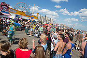 After marching down Surf Avenue, the parade rounte continued on the boardwalk. The Wonder Wheel can be seen in the background, as can Nathan;s Famous hot dog stand, and a crown of thousands of spectators.