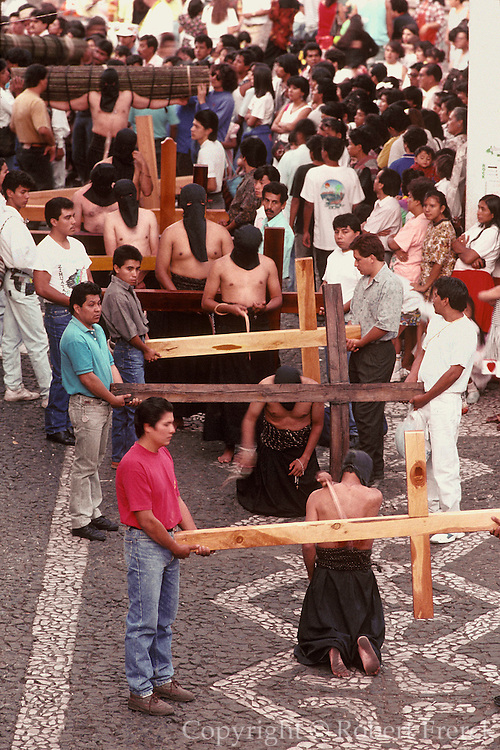 MEXICO, FESTIVALS, SEMANA SANTA Taxco, penitents on knees in procession