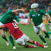 Eoin Reddan, Ireland, is tackled by Mike Phillips, Wales, as he gets his  pass away during the Ireland V Wales Quarter Final match at the IRB Rugby World Cup tournament. Wellington Regional Stadium, Wellington, New Zealand, 8th October 2011. Photo Tim Clayton...