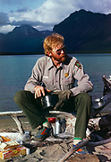 Backcountry Park Ranger Clair Roberts eating supper at Two Lakes, Lake Clark National Preserve, Alaska.