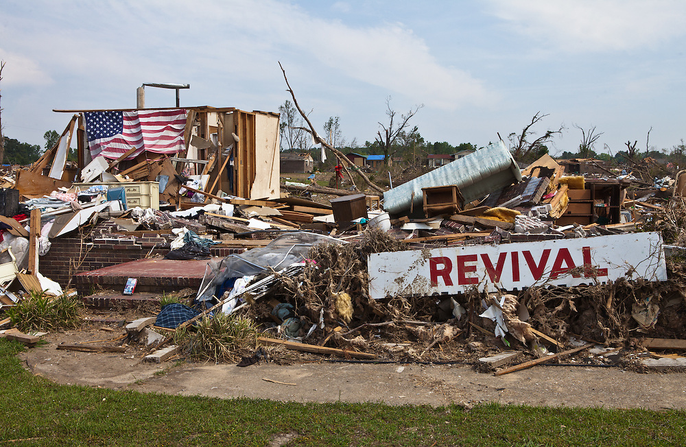 An American flag in front of a home totaled by a tornado in Alabama. Pleasant Grove, a suburb of Birmingham<br />  Alabama <br /> remains in a state of ruin over two weeks after it was hit by an F-4 ( possibly an F-5) tornado, one of an estimated 300 that struck Alabama and the neighboring states on April 27th , 2011.