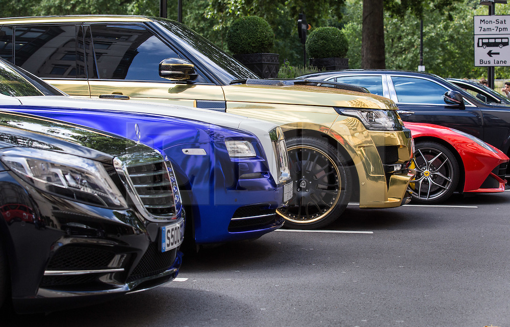 © Licensed to London News Pictures. 27/07/2015. London, UK. A collection of custom supercars with Saudi Arabian license plates seen outside the Dorchester Hotel in London. Kensington and Chelsea Borough Council have announced plans that will make it a criminal offence to cause excessive noise unnecessarily, which will aim to stop showboating by drivers revving their engines, or super-fast accelerating. Photo credit : James Gourley/LNP