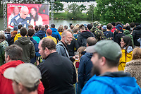 watching football at the Bigfoot Festival Ragley Hall Warwickshire one of the first festivals to open successfully in 2021,photo by Mark Anton Smith