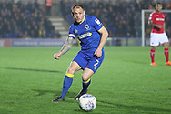 AFC Wimbledon defender Barry Fuller (2) looking for a through ball during the EFL Sky Bet League 1 match between AFC Wimbledon and Charlton Athletic at the Cherry Red Records Stadium, Kingston, England on 10 April 2018. Picture by Matthew Redman.