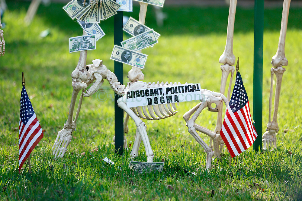 30 October 2015. New Orleans, Louisiana.<br /> The Skeleton Krewe mansion on St Charles Avenue at the corner of State Street draws crowds with its satirically spooky Halloween decorations. American Political Dogma.<br /> Photo©; Charlie Varley/varleypix.com