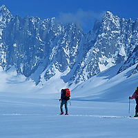 Expedition skiers on Europe's classic Haute Route Traverse cross France's Argentiere Glacier, en route from Chamonix, France to Zermatt, Switzerland.