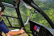 """Seen from a helicopter, Manawaiopuna Falls (aka """"Jurassic Falls"""") in Hanapepe Valley was spectacularly featured as the helipad location in the 1993 film """"Jurassic Park."""" Located on private land, the falls are best visited via helicopter tour over the island of Kauai, in the state of Hawaii, USA."""