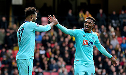 AFC Bournemouth's Joshua King (left) celebrates scoring his side's first goal of the game with team-mate AFC Bournemouth's Jordon Ibe (right) during the Premier League match at Vicarage Road, London.