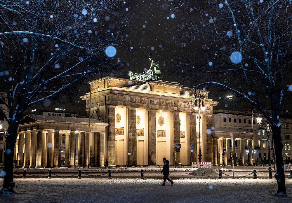 A view of the Brandenburg Gate during snowfall at the central Mitte district in Berlin, Germany, February 09, 2021. Germany is experiencing several days of sub-zero temperatures strong winds and snow.