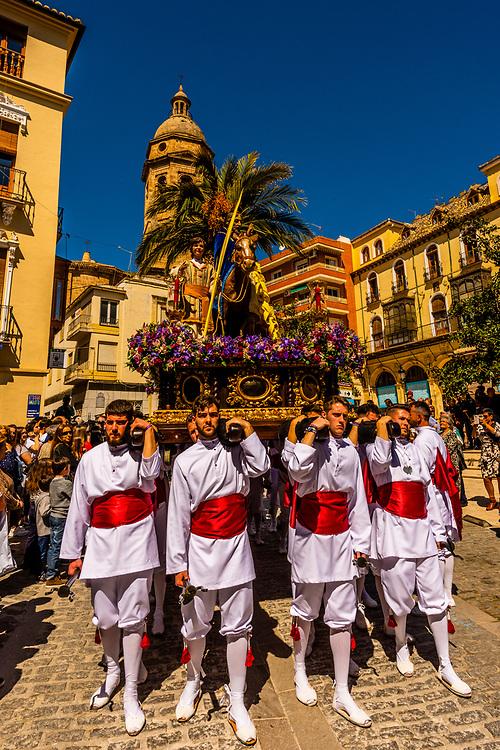 "A paso (float) carried by men called ""costaleros"" from the Brotherhood (Hermandad) de Nuestro Padre Jesus on Palm Sunday of Holy Week (Semana Santa), Loja, Granada Province, Andalusia, Spain."