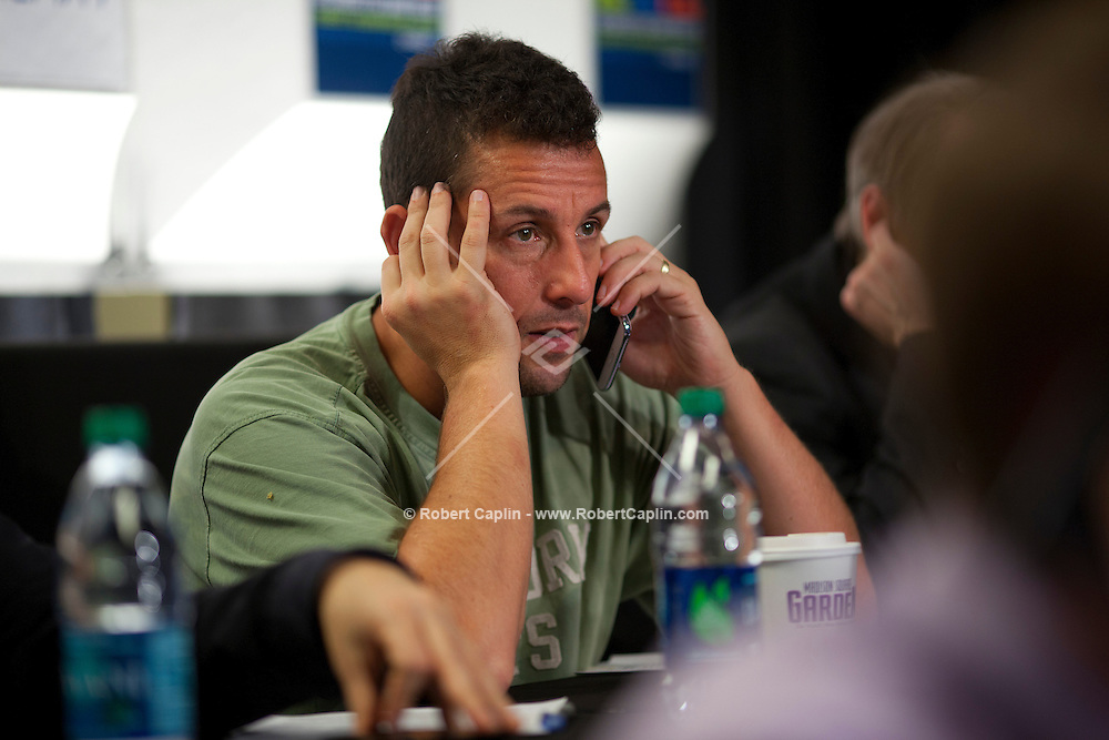 Adam Sandler works the phone banks at the 12-12-12 fundraising concert to aid the victims of Hurricane Sandy, will take place on December 12, 2012 at Madison Square Garden. The concert featured The Rolling Stones, Bon Jovi, Eric Clapton, Dave Grohl, Billy Joel, Alicia Keys, Chris Martin, Bruce Springsteen & the E Street Band, Eddie Vedder, Roger Waters, Kanye West, The Who, and Paul McCartney. All the proceeds went go to the Robin Hood Relief Fund. Robin Hood, the largest independent poverty fighting organization in the New York area, will insure that every cent raised will go to non-profit groups that are helping the tens of thousands.of people throughout the tri-state area who have been affected by Hurricane Sandy...Photo © Robert Caplin..
