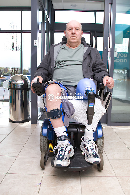 Male wheelchair coming through the automatic door of his local sports leisure centre,
