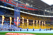 Flames shoot in to the air in front of a sea of colour in Wembley as the players come out on to the pitch for kick off in the The FA Cup Final match between Manchester City and Watford at Wembley Stadium, London, England on 18 May 2019.