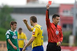 Damir Hadzic of Koper and referee Slavko Vincic with red card  at 34th Round of 1st Slovenian Football League match between NK Olimpija and NK Luka Koper, on May 5, 2010, in ZAK, Ljubljana, Slovenia.  (Photo by Vid Ponikvar / Sportida)