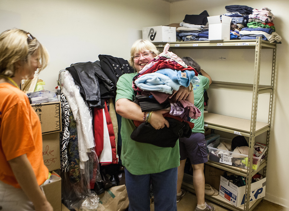 Barb Herzinger '93, President of the Lutheran Deaconess Conference help orgainze donated goods at Dayspring Women's Center in Valpariaso, IN. (Jeff Lange)
