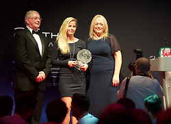 CARDIFF, WALES - Monday, October 5, 2015: Wales' Kylie Davies receives the Women's Fans' Favourite Award from FAW President David Griffiths and Vauxhall's Cheryl Stibbs during the FAW Awards Dinner at Cardiff City Hall. (Pic by Ian Cook/Propaganda)
