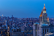 View of the Manhattan Municipal Building from The Beekman in New York City showing midtown in the background, shot at dusk.