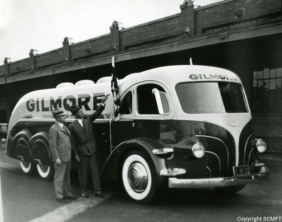 1939 Earl Gilmore by one of his Gilmore Oil trucks