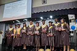 The Class of 2016 stand with their diplomas.  St. Thomas/St. John Seventh Day Adventist School Commencement Service.  Bertha C. Boschulte Auditorium.  St. Thomas, USVI.  12 June 2016.  © Aisha-Zakiya Boyd