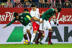 November 13, 2017 - Gdansk, Poland - Mariusz Stepinski (POL), Jonathan dos Santos (MEX), Hector Moreno (MEX) during the International Friendly match between Poland and Mexico at Energa Stadium in Gdansk, Poland on November 13, 2017. (Credit Image: © Foto Olimpik/NurPhoto via ZUMA Press)