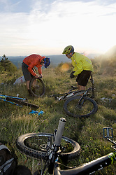 two mountain bikers repairing bicycle tyre, Vipava valley, Istria, Slovenia