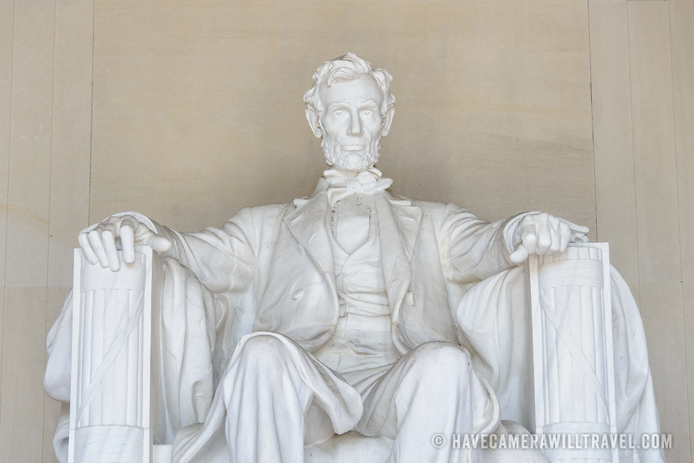 Abraham Lincoln Statue at Lincoln Memorial Front View. Detail of the statue of a seated President Abraham Lincoln gazing out from the Lincoln Memorial towards the Washington Monument and the U.S. Capitol.