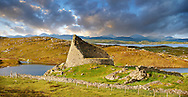 Pictures of Dun Carloway Broch on the Isle of Lewis in the Outer Hebrides; Scotland. Brochs are among Scotland's most impressive prehistoric buildings and were the precursors of the Medieval Scottish Tower Houses. The world Broch is derived from lowland scots who called forts Brough from the old Norse Borg.; Broch stone roundhouses date from about 2; 300 to 1; 900 years ago; and are found mainly in north and west Scotland. Dun Carloway Broch was probably built around the time of the Roman occupation in Britain in 43AD and was probably the primary dwelling-places for the principal family in the area. Dun Carloway Broch would have provided some protection against sporadic raiding; but were not purely defensive structure but a focal point for the clan of the area. .<br /> <br /> Visit our SCOTLAND HISTORIC PLACXES PHOTO COLLECTIONS for more photos to download or buy as wall art prints https://funkystock.photoshelter.com/gallery-collection/Images-of-Scotland-Scotish-Historic-Places-Pictures-Photos/C0000eJg00xiv_iQ<br /> '<br /> Visit our PREHISTORIC PLACES PHOTO COLLECTIONS for more  photos to download or buy as prints https://funkystock.photoshelter.com/gallery-collection/Prehistoric-Neolithic-Sites-Art-Artefacts-Pictures-Photos/C0000tfxw63zrUT4