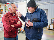 "24 JANUARY 2020 - POLK CITY, IOWA: JOE WALSH, left, talks to JAMES MARREN, from the Veterans National Recovery Center, before a campaign event in Polk City, northwest of Des Moines. Walsh, a conservative radio personality, former Republican congressman, and one time supporter of Donald Trump is now challenging Trump for the Republican nomination for the US Presidency. During his appearance in Polk City, Walsh said Trump is unfit to be the President because he is a ""cheater,"" a climate change denier, and a ""threat"" to the United States.      PHOTO BY JACK KURTZ"