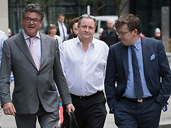 © Licensed to London News Pictures. 03/07/2017. London, UK. Newcastle United owner Mike Ashley  (C) arrives at the High Court surrounded by his legal team. Mr Ashley is in dispute with financial expert  Jeffrey Blue over payments promised in relation to the share price of Sports Direct. Photo credit: Peter Macdiarmid/LNP