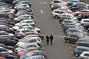 A young couple walks through the car park of Lakeside, the giant Essex shopping mall on the outskirts of London.