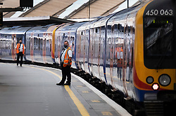 © Licensed to London News Pictures. 07/09/2020. London, UK. Rail staff wait for a train to depart at Waterloo Station. Train capacity is supposed to reach 90% today as holidays come to an end and schools return. Photo credit: Peter Macdiarmid/LNP