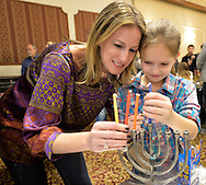 LAUREN ROSENBERG and her daughter EMMY ROSENBERG, 8, of Merrick, set up a menorah at the Merrick Jewish Centre attempt to regain the Guinness World's Record for Most Menorot Lit in One Place at One Time that the congregation held in 2011. On the third night of Hanukkah, the 'Light Up the Night 2 - Bringing the Record Home' event also included a ceremonial candle lighting in the main sanctuary.