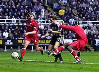 Photo. Glyn Thomas.<br /> Newcastle United v Middlesbrough. Premiership.<br /> St James' Park, Newcastle. 21/02/2004.<br /> Newcastle's Craig Bellamy (C) equalises as Boro's Gareth Southgate (L) and Ugo Ehiogu are powerless to stop him.