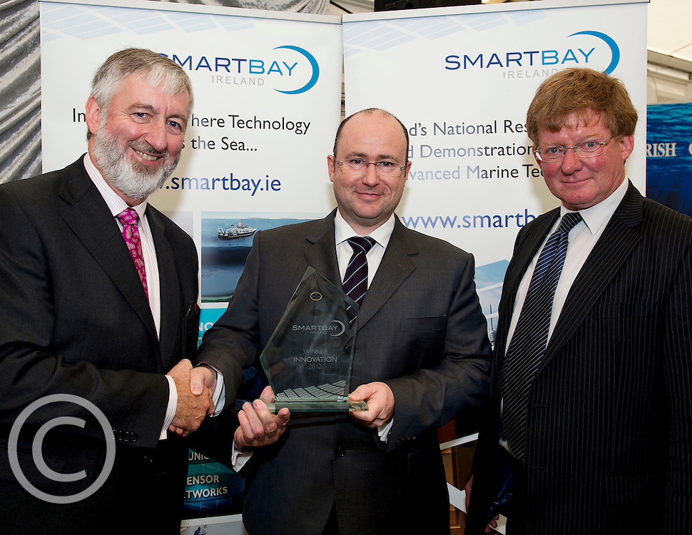 Mike Devane SMARTBAY presenting Andrew Parish and Dr. Patrick Hartigan wave bob with his SMARTBAY Overall innovation award of the year at the SmartOcean Innovation Exchange at the Volvo Global Village. Photo:Andrew Downes. Photo issued with Compliments no reproduction fee..