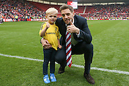 Middlesbrough defender Jonathan Woodgate (39)  with his son during the Sky Bet Championship match between Middlesbrough and Brighton and Hove Albion at the Riverside Stadium, Middlesbrough, England on 7 May 2016. Photo by Simon Davies.
