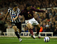 Photo: Chris Ratcliffe.<br /> Arsenal v Juventus. UEFA Champions League. Quarter-Finals. 28/03/2006.<br /> Cesc Fabregas tussles with Mauro Camoranesi