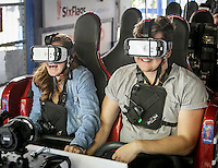 Maycie Thornton and Chris Timpone of Buzzed get ready to ride on the New Revolution roller coaster which features Virtual Reality at Six Flags Magic Mountain in Valencia, CA. March 25, 2016.