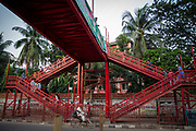 A red walkway for pedestrians over the Kazi Nazrul Islam Avenue outside Tejgaon government, girls high school on the 23rd of September 2018 in Dhaka, Bangladesh.  (photo by Andrew Aitchison / In pictures via Getty Images)