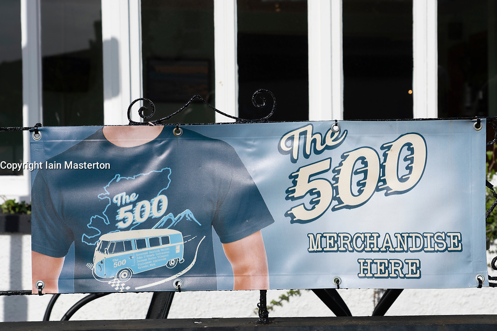 Poster advertising merchandise for North Coast 500 in Ullapool on he North Coast 500 scenic driving route in northern Scotland, UK