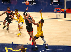 Jan 25, 2021; Morgantown, West Virginia, USA; Texas Tech Red Raiders forward Marcus Santos-Silva (14) makes a move and shoots around West Virginia Mountaineers forward Derek Culver (1) during the second half at WVU Coliseum. Mandatory Credit: Ben Queen-USA TODAY Sports