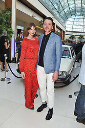 SIENNA GUILLORY and ENZO CILENTI at a VIP dinner hosted by Maserati following the unveiling of the new Maserati 'Quattroporte' at The Hurlingham Club, London on 17th April 2013.