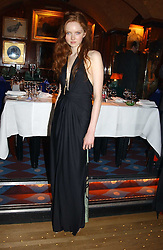 LILY COLE at a private dinner and presentation of Issa's Autumn-Winter 2005-2006 collection held at Annabel's, 44 Berkeley Square, London on 15th March 2005.<br /><br />NON EXCLUSIVE - WORLD RIGHTS