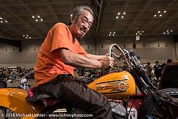Panhead Man Yukio Sakuma of Sons Motorcycles in Chiba Japan at the Mooneyes Yokohama Hot Rod & Custom Show. Yokohama, Japan. December 4, 2016.  Photography ©2016 Michael Lichter.